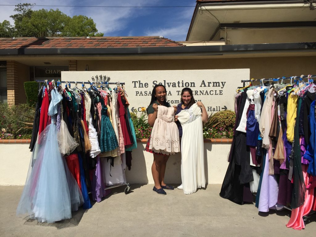 Delivering 163 prom dresses to the Salvation Army after the collection in 2015