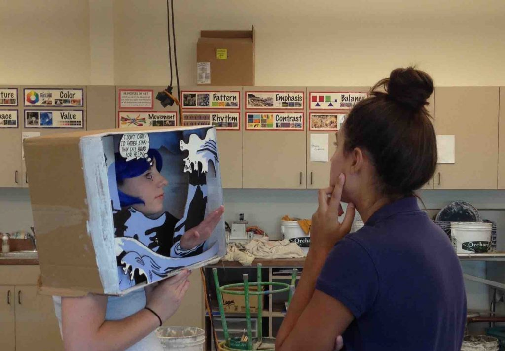 Emily Gray '17, Sculpture 3, works on final touches for her Remake of Roy Lichtenstein's Drowning Girl with cousin Madeline Gray '18 as her model.